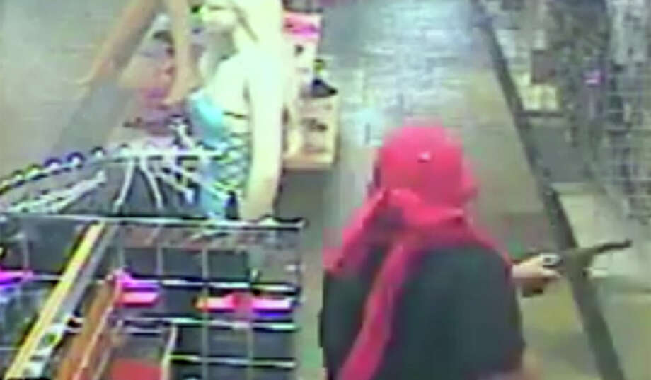 Surveillance photos of an armed robbery April 13 at Katz Boutique. Photo: HPD