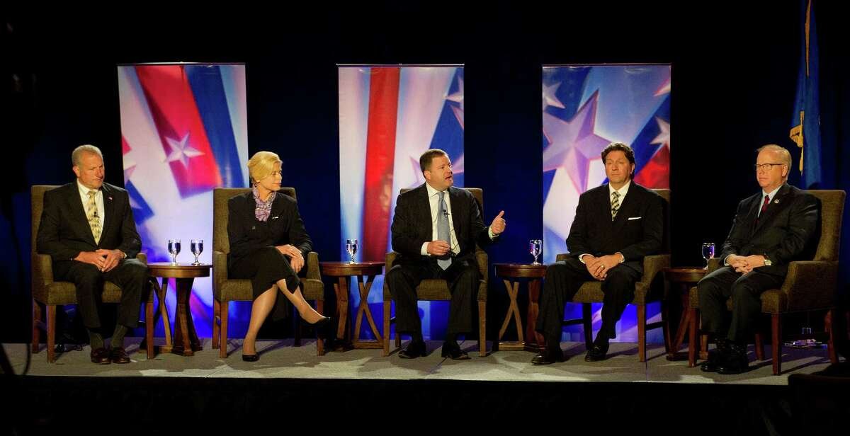 during a debate between five of the six republican candidates for Governor of Connecticut at the Sheraton in Stamford, Conn., on April 30, 2014. From left are Mark Lauretti, Martha Dean, John McKinney, Joseph Visconti and Mark Boughton.
