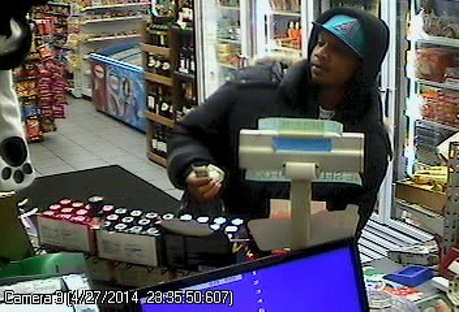 Leroy Henderson, 30, was captured in surveillance footage shopping at a convenience store shortly before he was fatally shot April 27. Prosecutors filed aggravated first-degree murder charges Wednesday against Ali Muhammad Brown for Henderson's death. Photo: King County Sheriff's Office