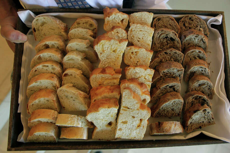 An assortment of bread at the new Pelican club on Thursday, April 17, 2014, in Galveston. The new Pelican Club will be open to the public, featuring award-winning chef Ross Warhol, who will create an impressive experience for guests, and put Galveston on the global culinary map. ( J. Patric Schneider / For the Chronicle ) Photo: J. Patric Schneider, For The Chronicle / © 2014 Houston Chronicle