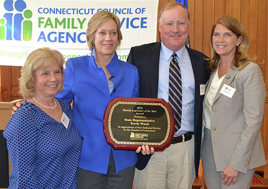 "State Rep. Terrie Wood, R-Darien, second from left, is congratulated after receiving the ""Family Legislator of the Year"" award from the Connecticut Council of Family Service Agencies. With her, from left, Darien Selectman Susan Marks, Selectman Jerry Nielsen and First Selectman Jayme Stevenson. Photo: Contributed Photo, Contributed / Darien News"