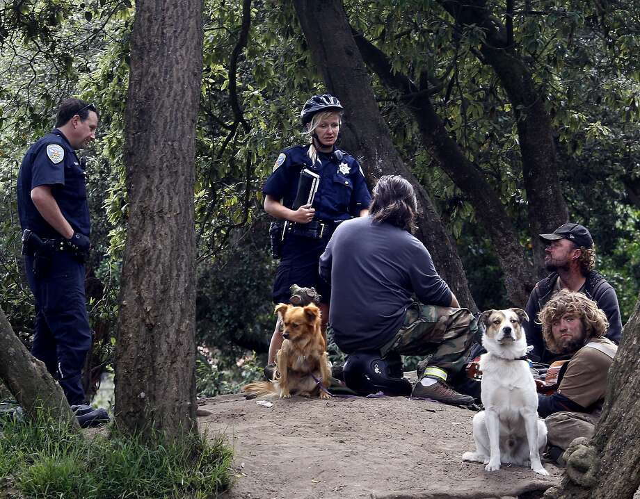 Homeless people like these in Golden Gate Park could face penalties for violating San Francisco's law prohibiting sitting or lying on public sidewalks. Photo: Brant Ward, The Chronicle