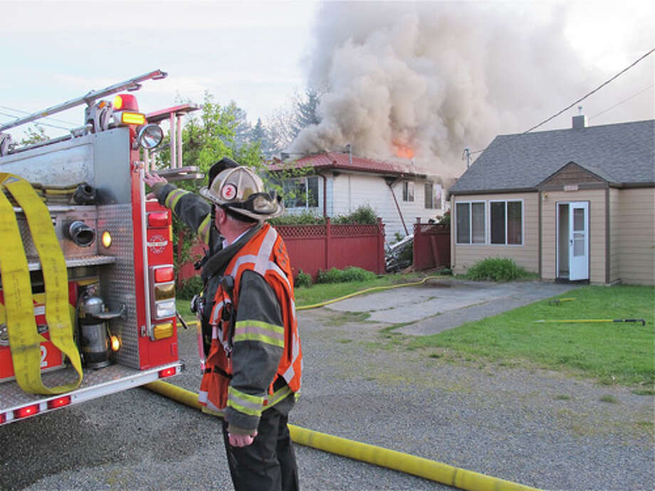 Seattle firefighters tackled a blaze Tuesday night in Arbor Heights that destroyed a home and landed an elderly pair in the hospital. Photo: Seattle Fire Department