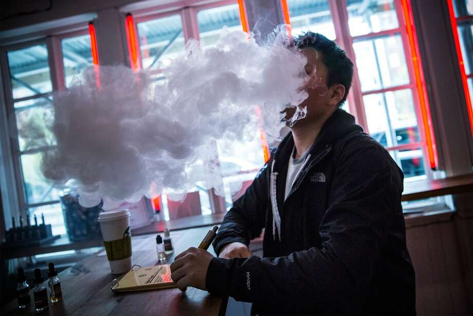 "Rules for e-cigs:Tom Kim ""vapes"" (smokes an electronic cigarette) at Henley Vaporium in New York City. A 