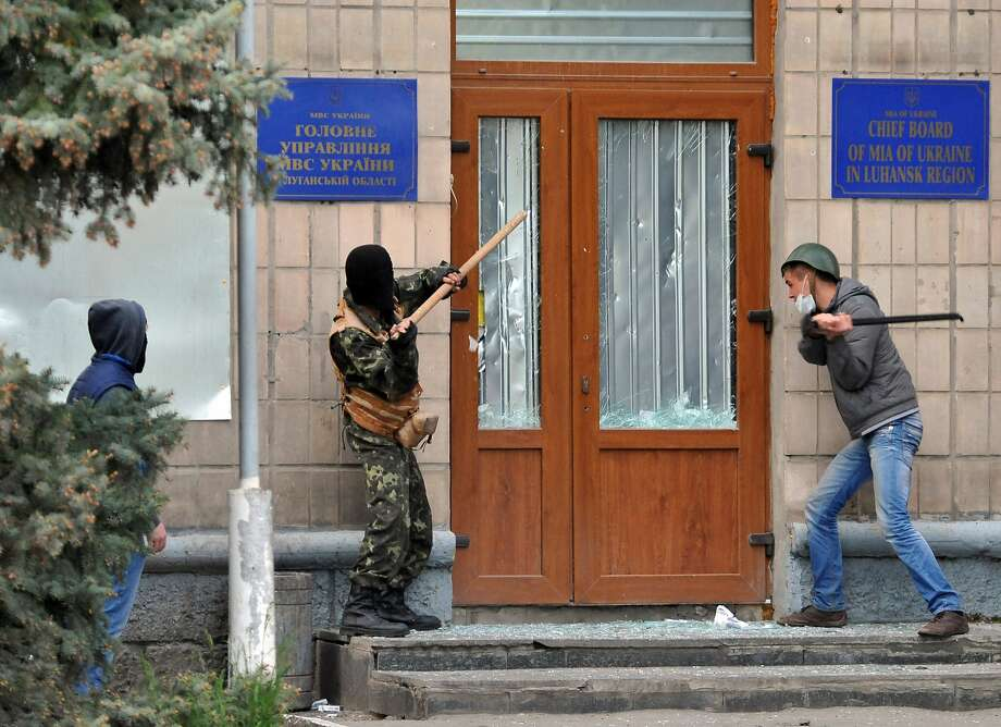 Somebody call the police! Pro-Russian activists smash the door of the 