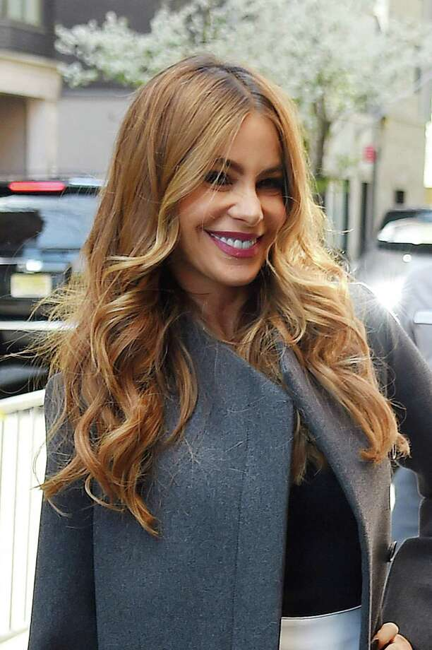 Sofía Vergara  A center part and a few face-framing layers keep the attention on healthy, wavy hair. If yours is currently less than shiny, let Pantene's Repair & Protect Overnight Miracle Repair Serum ($7.99) take care of damage while you sleep. Photo: NCP/Star Max, Getty Images / 2014 Star Max