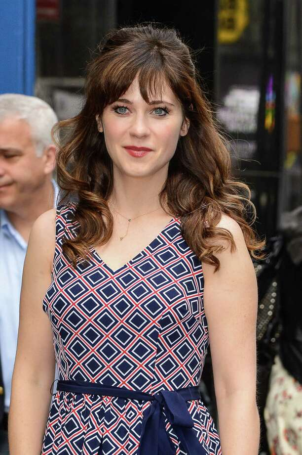"Zooey Deschanel  Bangs with longer hair can be a tricky balance to pull off, but Zooey gets it just right with a fringe cut in a slight horseshoe shape. ""Gently tapering the outer edges to join the longer layers on the sides blends the different lengths together,"" says Hill. ""She also gets the texture right by keeping hair smoother until mid-length and adding movement at the ends."" Photo: Ray Tamarra, Getty Images / 2014 Ray Tamarra"