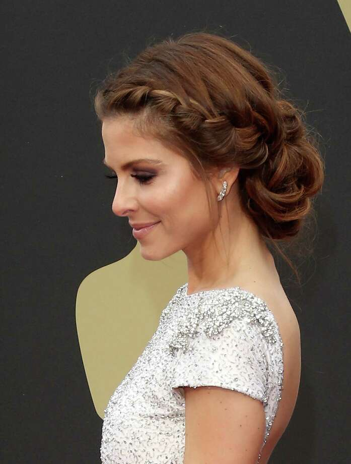Maria Menounos Re-create this Oscar-ready braided updo by working a mousse through your hair to boost waves and creating French braids framing each side of the face. Stop braiding at the nape and secure each side with small rubber bands. Then coil all of your hair in half-inch pieces and secure with bobby pins around the nape, creating an unstructured, round shape. Photo: Dan MacMedan, Getty Images / 2014 Dan MacMedan