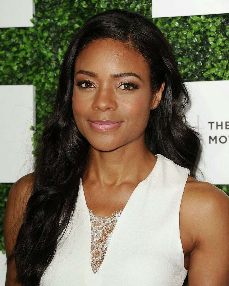 """Naomie Harris""""Naomie's layers fall around her jawline, giving softness and femininity to her style,"""" says Hill of the star's layered cut with loose waves. It's also super-versatile—she can pump up the curls or blow-dry her hair straight. Photo: Jason LaVeris, Getty Images / 2014 Jason LaVeris"""