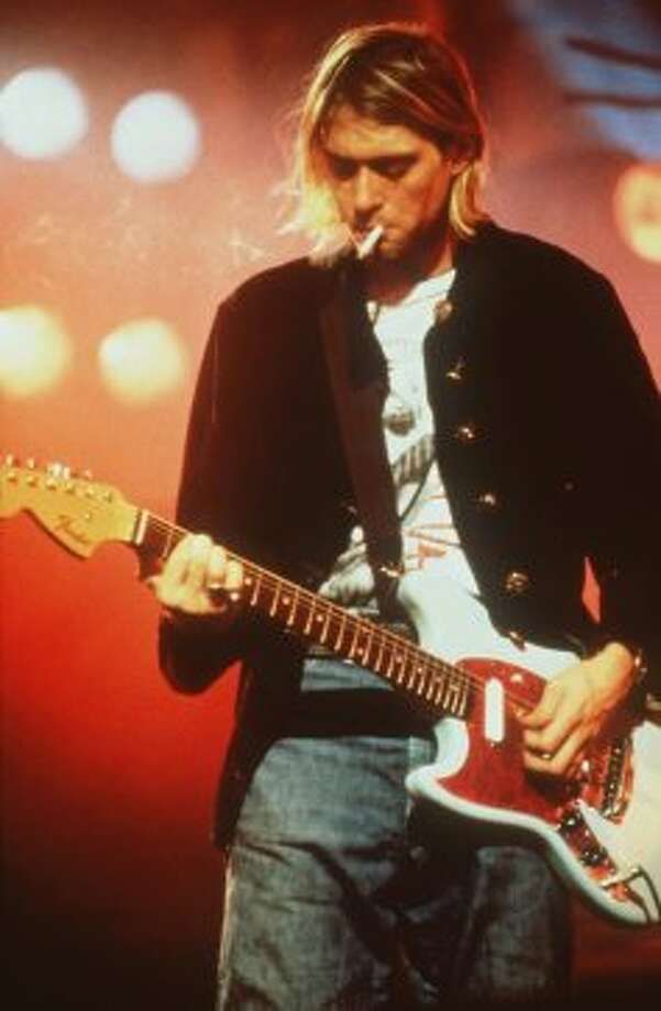 A file photo of Nirvana lead singer and guitarist Kurt Cobain performing on stage. Photo: AP