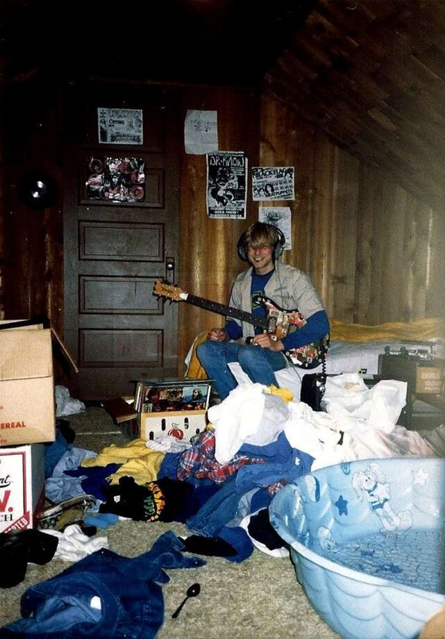 A young Kurt Cobain plays guitar in his childhood home in Aberdeen, Wash. Photo: Courtesy Kim Cobain, AP