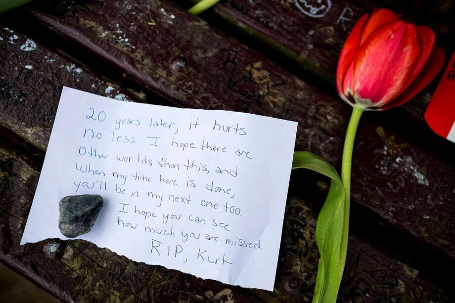 Fans of Nirvana's lead singer, Kurt Cobain, paid homage to the late rock icon with offerings of flowers, unopened beers and handwritten notes on a bench near the home where Cobain died on the 20th anniversary of his death Saturday, April 5, 2014, at Viretta Park in Seattle, Wash. Photo: Jordan Stead, AP