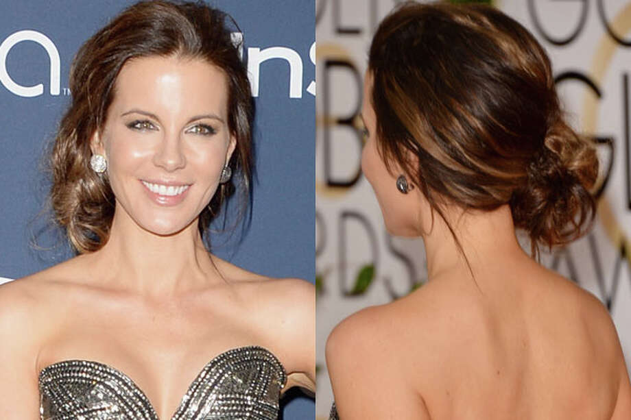 Kate Beckinsale  While a piled-high topknot has been the cool-girl updo of choice for the past few years, there's something simple and elegant about a loose, low bun. The effect is particularly striking on hair with visible highlights and a few strands hanging loose. Photo: Getty Images