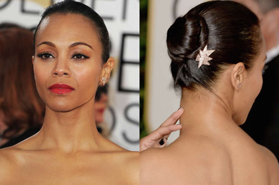 Zoe Saldana Sweep straight or freshly blown-out hair into a tight mid-height bun finished with a jeweled barrette—as the weather gets warmer, it's perfect for showing off bare shoulders in a strapless dress or open-backed blouse. Photo: Getty Images