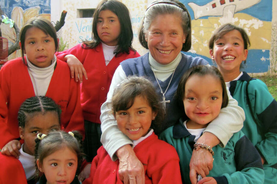 Sister Valeriana Isabel Garcia Martin and several of the children at Hogares Luz y Vida in Bogota, Colombia. Photo: Contributed Photo, Contributed / Darien News Contributed