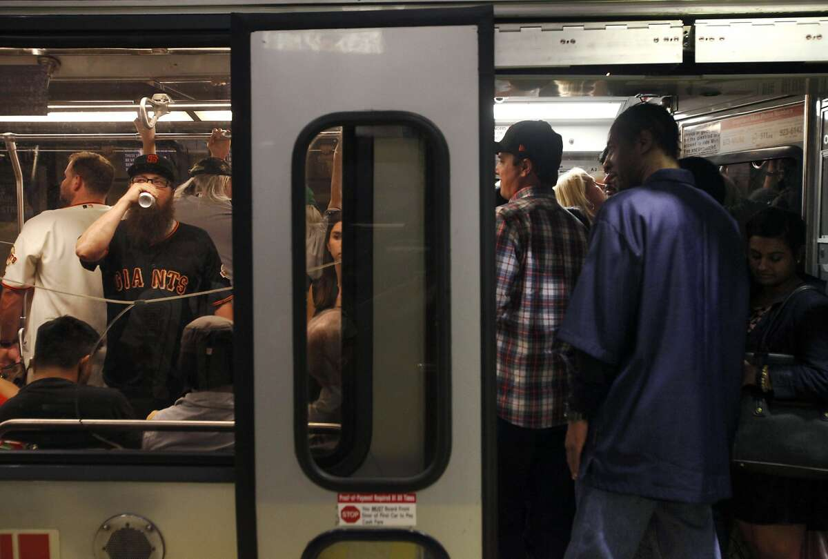 People crowd on to the Muni T line headed towards the ballpark at the Embarcadero station April 29, 2014 in San Francisco, Calif. Angelika Ryan, who takes her family to Giants games via the T line a few times a year says it's always this packed and it's worse on the weekends.