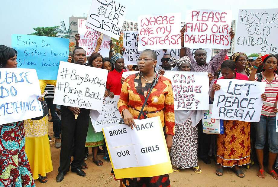 Ex-Education Minister Obiageli Ezekwesilieze, center, leads a march in the capital, Abuja, of mothers of girls kidnapped by Islamic militants. They are demanding the government do more to rescue them. Photo: Philip Ojisua, AFP/Getty Images