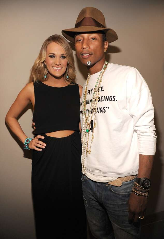 Carrie Underwood and Pharrell Williams backstage at the TIME 100 Gala, TIME's 100 most influential people in the world at Jazz at Lincoln Center on April 29, 2014 in New York City. Photo: Kevin Mazur, Getty Images For TIME