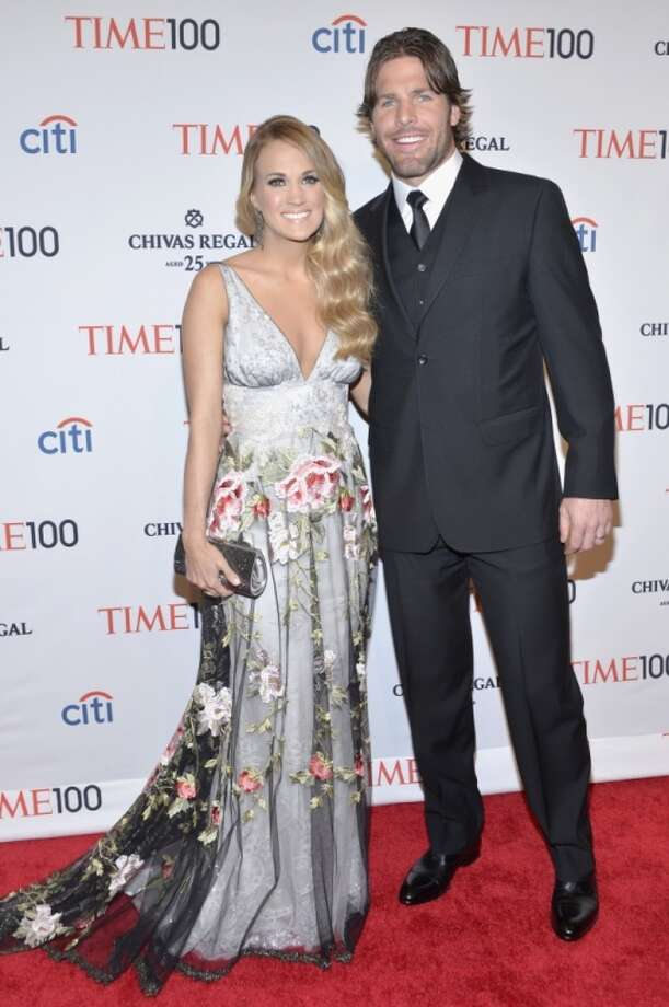 Honoree Carrie Underwood (L) and husband Mike Fisher attend the TIME 100 Gala, TIME's 100 most influential people in the world, at Jazz at Lincoln Center on April 29, 2014 in New York City. Photo: Ben Gabbe, Getty Images For TIME