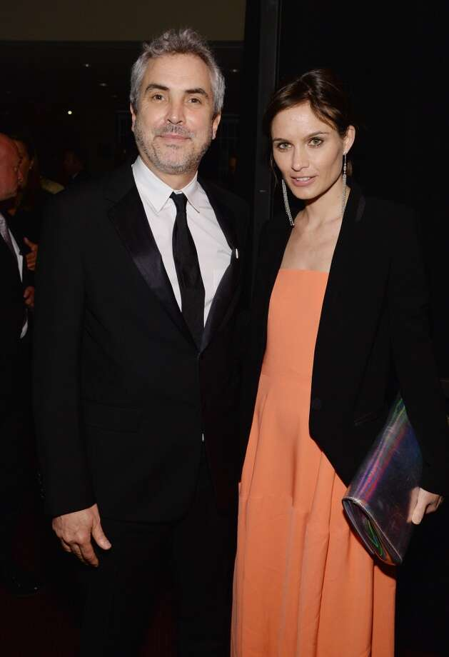 Honoree Alfonso Cuaron and Sheherazade Goldsmith attend the TIME 100 Gala, TIME's 100 most influential people in the world, at Jazz at Lincoln Center on April 29, 2014 in New York City. Photo: Larry Busacca, Getty Images For TIME