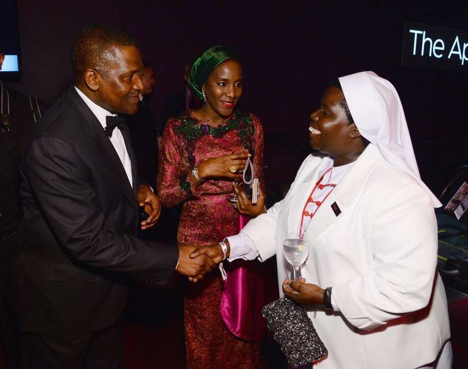 (L-R) Honoree Aliko Dangote, Halima Dangote, and honoree Sister Rosemary Nyirumbe attend the TIME 100 Gala, TIME's 100 most influential people in the world, at Jazz at Lincoln Center on April 29, 2014 in New York City. Photo: Larry Busacca, Getty Images For TIME