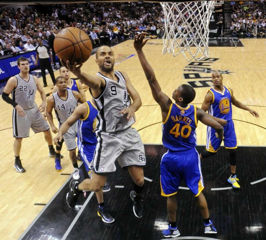 2013 Western Conference Semifinals vs. Golden State Warriors: After an exciting back-and-forth series, including a double OT in Game 1 for a 129-127 Spurs win, the Spurs come back from a 97-87 overtime loss in Game 4 to take back-to-back wins in Games 5 (109-91) and 6 (94-82), winning the series. They go on to sweep the Memphis Grizzlies in the Western Conference Finals.PHOTO: The Spurs' Tony Parker shoots around the Warriors' Harrison Barnes during first half action in Game 5 in the Western Conference semifinals on May 14, 2013, at the AT&T Center. Photo: Edward A. Ornelas, San Antonio Express-News