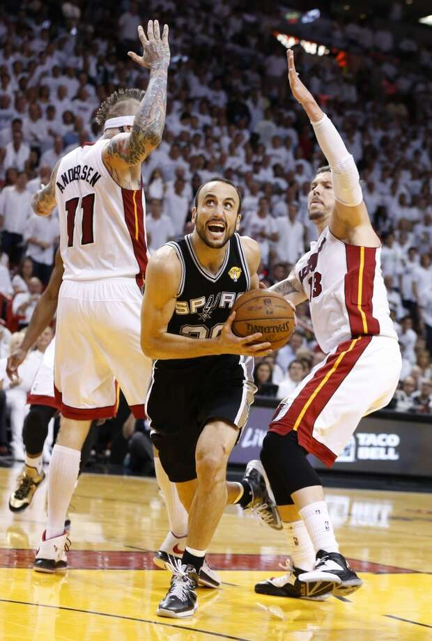 2013 NBA Finals vs. Miami Heat: The Spurs win Game 5 (114-104) at home after splitting the series, then take a tough pair of losses in Games 6 (100-103) and 7 (88-95) ... PHOTO: The Spurs' Manu Ginobili drives between the Heat's Chris Andersen and Mike Miller on his way to the hoop during the first half of Game 7 of the NBA Finals on June 20, 2013 at American Airlines Arena in Miami. Photo: Edward A. Ornelas, San Antonio Express-News