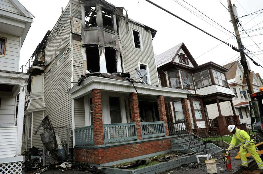 National Grid works to disconnect gas at a fire scene 16 Eagle St. on Wednesday, April 30, 2014, Schenectady, N.Y.  (Cindy Schultz / Times Union) Photo: Cindy Schultz / 00026694A