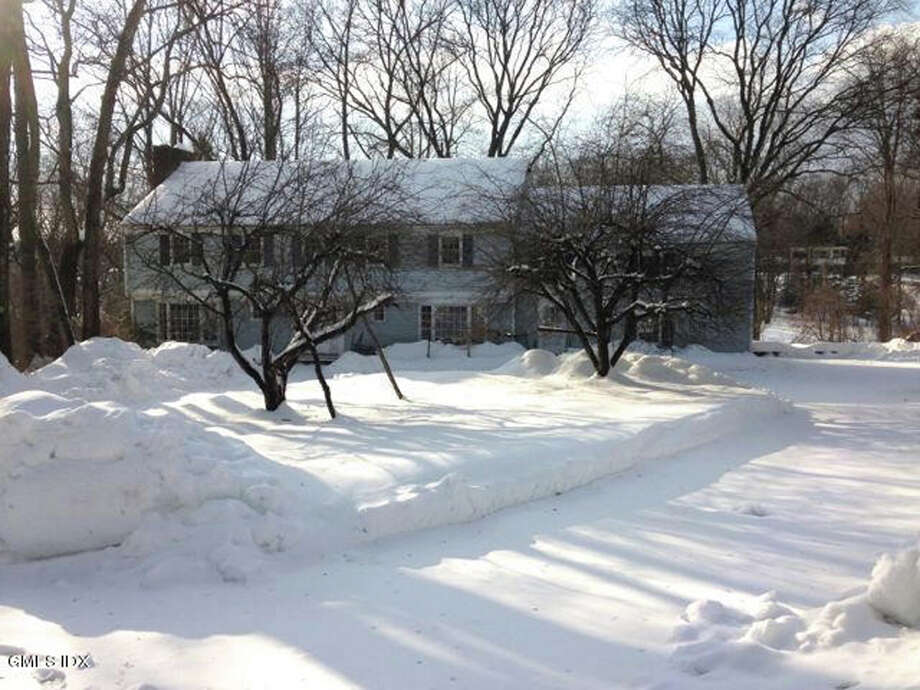"Ken Edwards' ìBuy of the Weekî was the property at 33 Laub Pond Road, ""a vacant Colonial estate sale on four acres with a lake for fishing, boating and ice skating."" Photo: Contributed Photo / Greenwich Time Contributed"