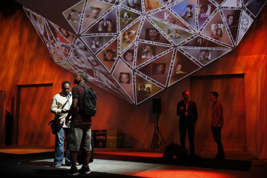 Navarrow Wright, Maximum Leverage Solutions/Close the Divide project CEO, left, and Lawrence Jones, Unlaced senior software engineer, talk underneath a 360 degree geometric production screen. Photo: Lea Suzuki, The Chronicle