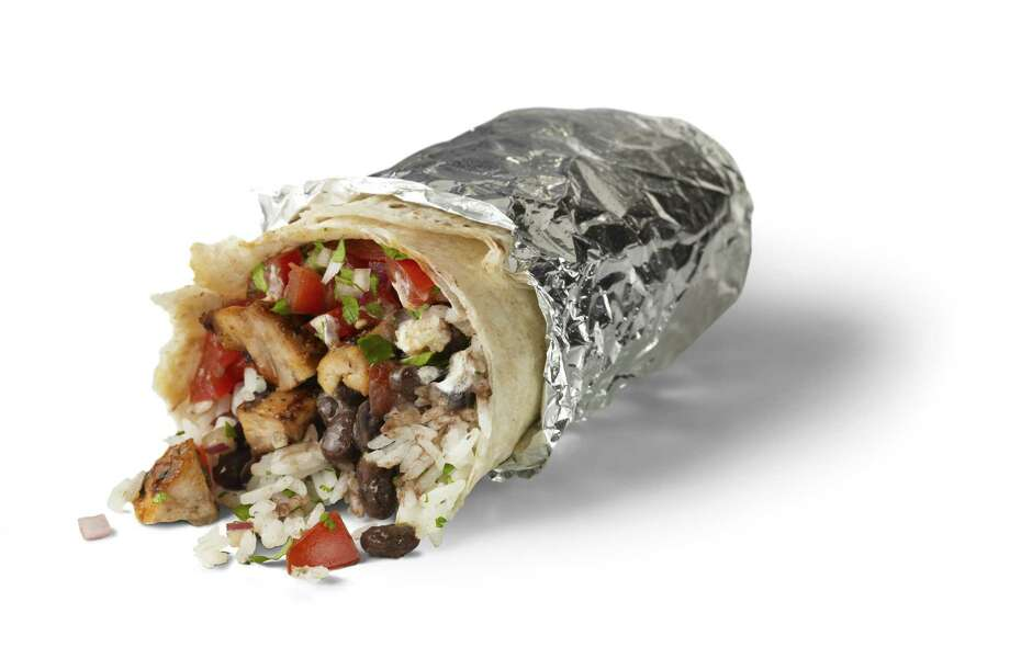 Chipotle, which offers fast-casual Mexican fare like this burrito, is one of the rising number of restaurants filling the public craving for tacos and burrito bowls. (Beth Galton)