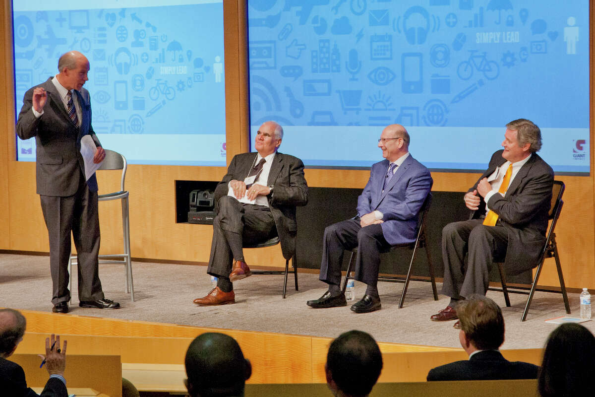Bill Purcell, left, president of the Greater Valley Chamber of Commerce, standing, leads a panel discussion last year at Leadercast, with from left, Robert Scinto, David Adler and Ed Schultek in Shelton, Conn. in May 2013.