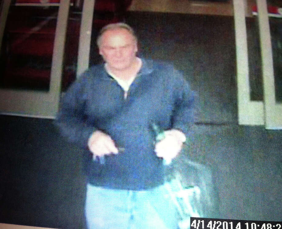 A surveillance video shows Eugene Gundelach as he leaves a store with a large glass jug police say he later smashed in a Lordship roadway. Photo: Contributed Photo, Contributed Photo / Connecticut Post Contributed
