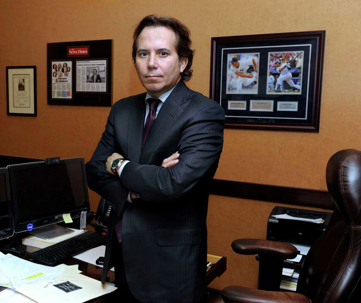 Danbury Attorney Augie Ribeiro is leading a team of high profile lawyers who are going after General Motors for it's ignition switch issues. Ribeiro is photographed in his office in downtown Danbury Wednesday, April 30, 2014.