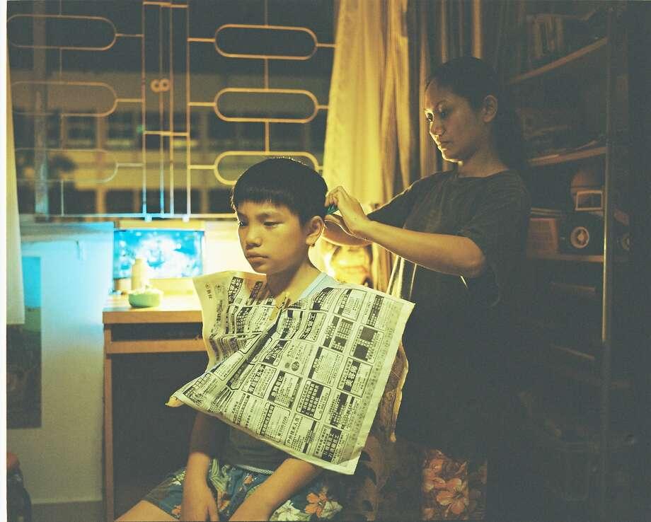 "Jiale (Koh Jia Ler) and Teresa (Angeli Bayani) in ""Ilo Ilo,"" a prizewinner at the Cannes Film Festival. Photo: Film Movement"