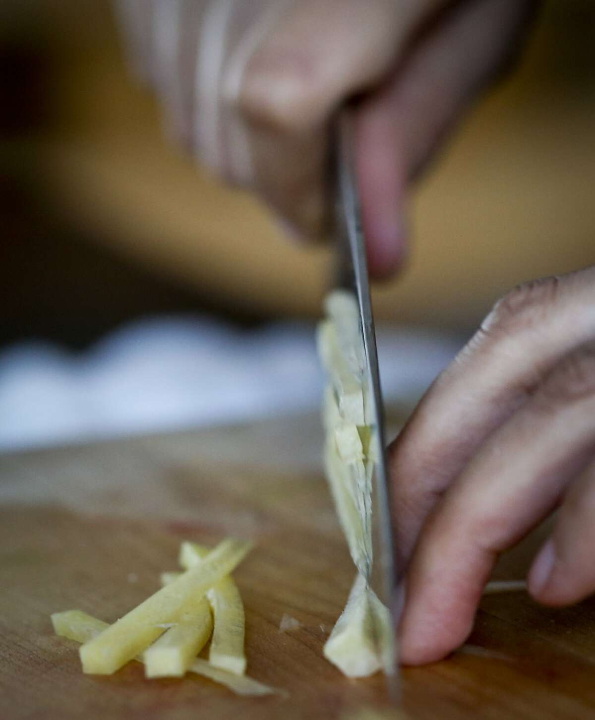 McCollow slices jicama for Aguachile Verde Ceviche, a signature dish at her restaurant.