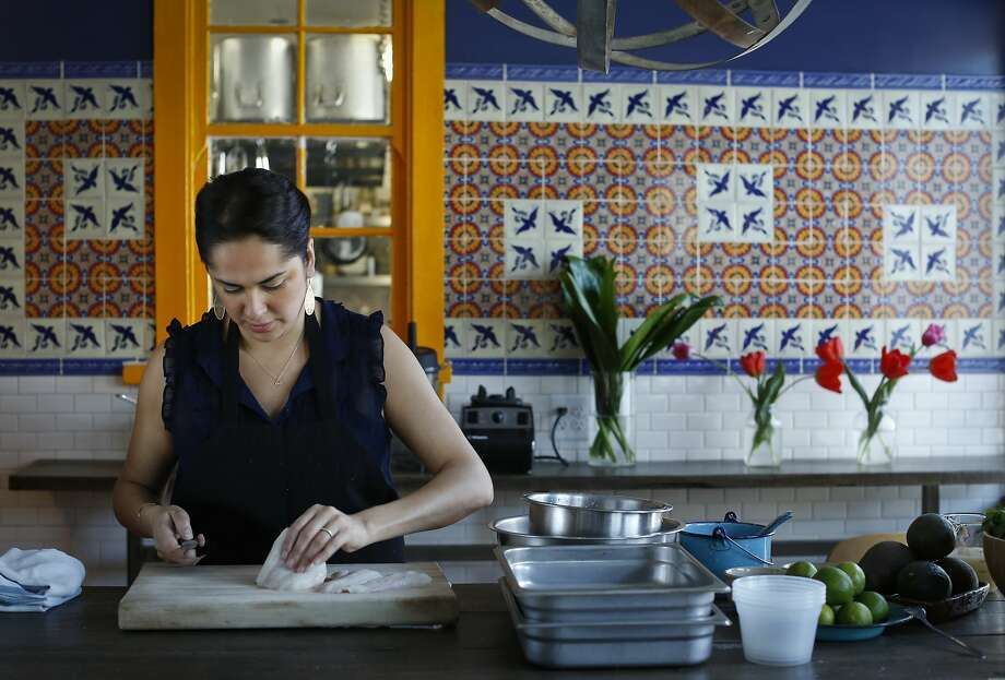 Silvia McCollow, chef/owner of Nido, slices halibut for her Aguachile Verde Ceviche, which also includes jicama, fresh green chiles and tomatillos. Photo: Russell Yip, The Chronicle