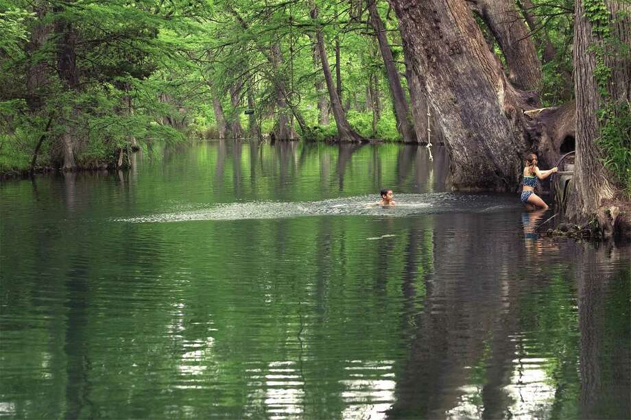 The Blue Hole in Wimberley is a popular Texas swimming spot. / Blue Hole Regional Park