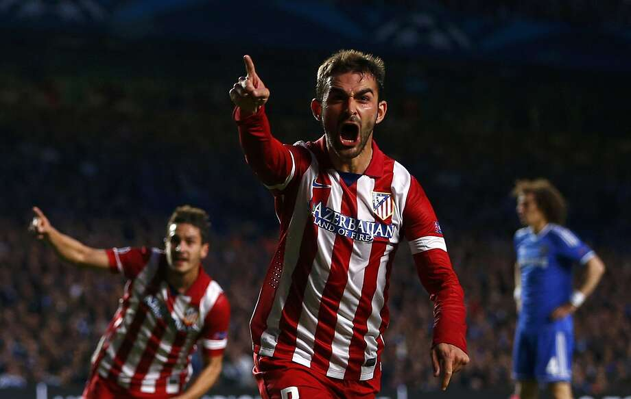 Adrian Lopez celebrates after scoring Atletico Madrid's first goal during their Champions League semifinal at Chelsea. Photo: Eddie Keogh, Reuters