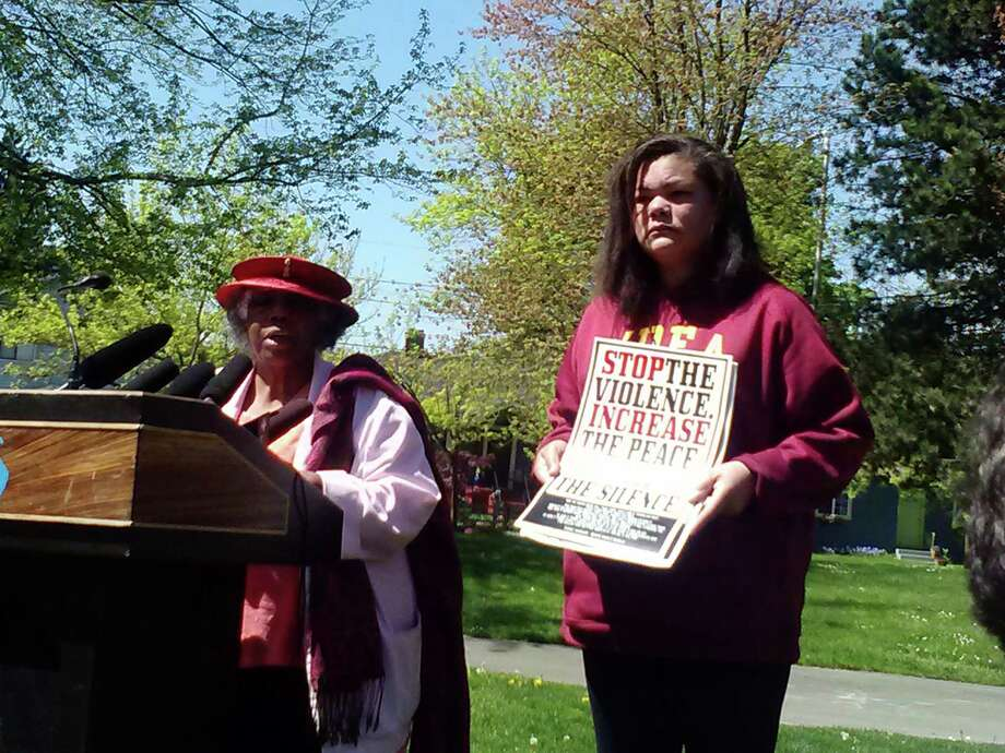 Ellen Larkins, right, stands alongside Rev. Harriett Walden Wednesday afternoon in Powell Barnett Park, calling for an end to gun violence. Photo: Lynsi Burton/seattlepi.com