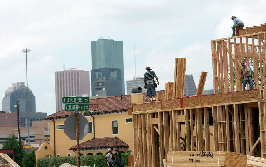 Prices of houses, like this one going up southeast of downtown, are up 9.4 percent overall from 2013. Inside Loop 610, they rose 12 percent, and between the Loop to Beltway 8 they're up nearly 20 percent. Photo: Johnny Hanson / © 2014  Houston Chronicle