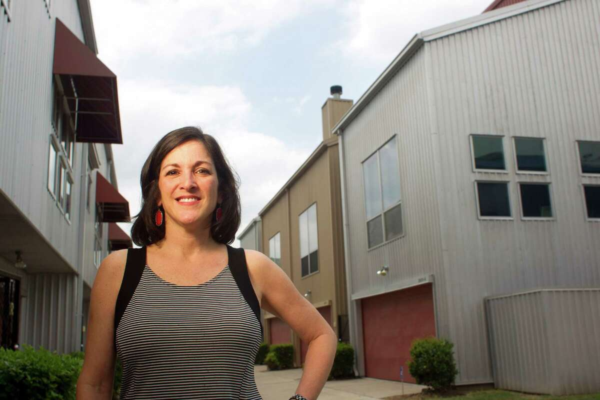 Taylor Nussbaum outside her home in the Calumet Street Lofts in the Riverside Terrace neighborhood just southeast of downtown Friday, April 25, 2014, in Houston. Nussbaum, who purchased her townhome in February, said there is now another similar town home her complex for sale for more than $40,000 than what she paid for her home. ( Johnny Hanson / Houston Chronicle )