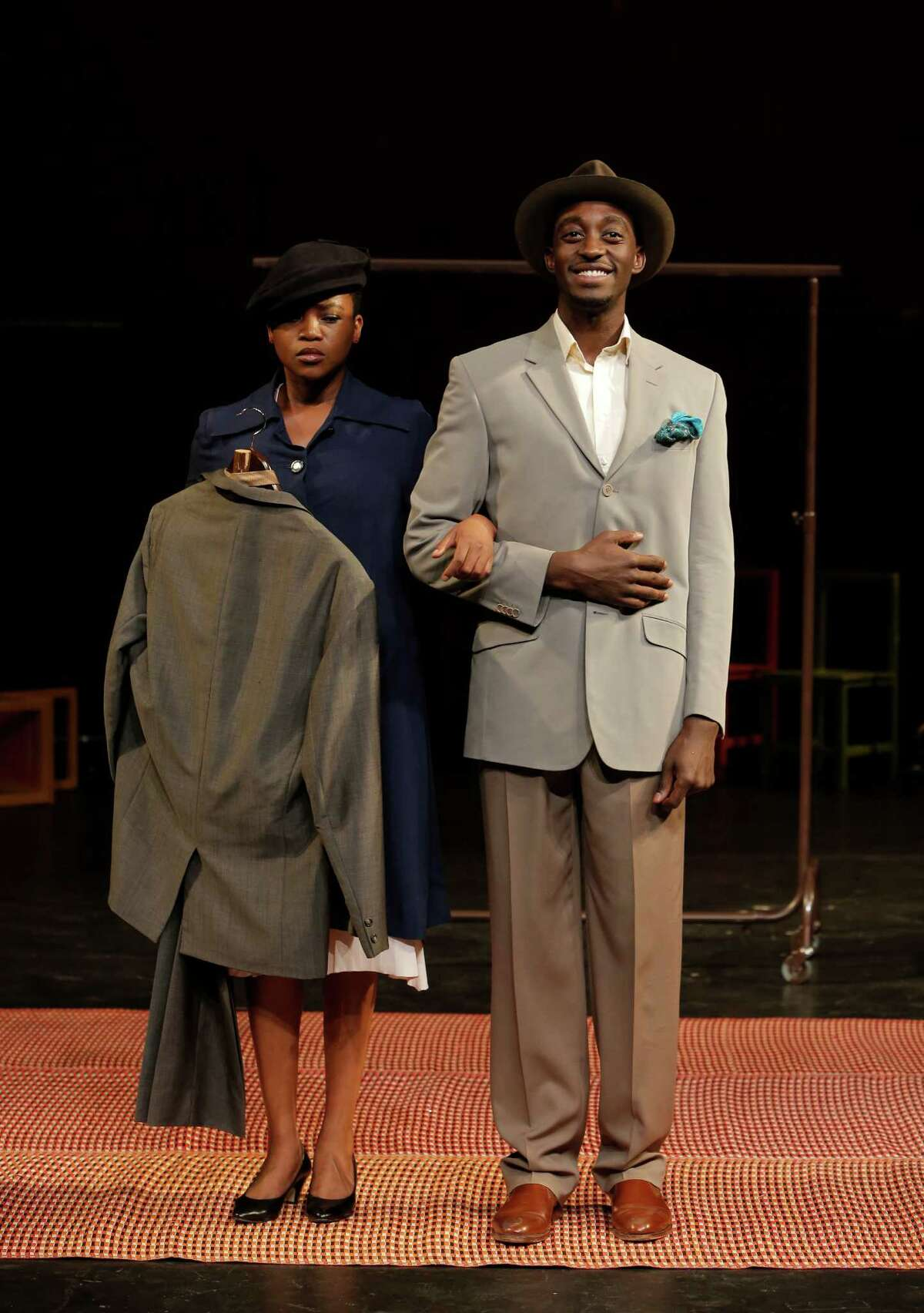 """Matilda (Nonhlanhla Kheswa, left) carries the suit left behind by her lover when she walks with her husband Philemon (Ivanno Jeremiah) in """"The Suit"""" at American Conservatory Theater, which won the top imported-production honor for the Peter Brook play."""