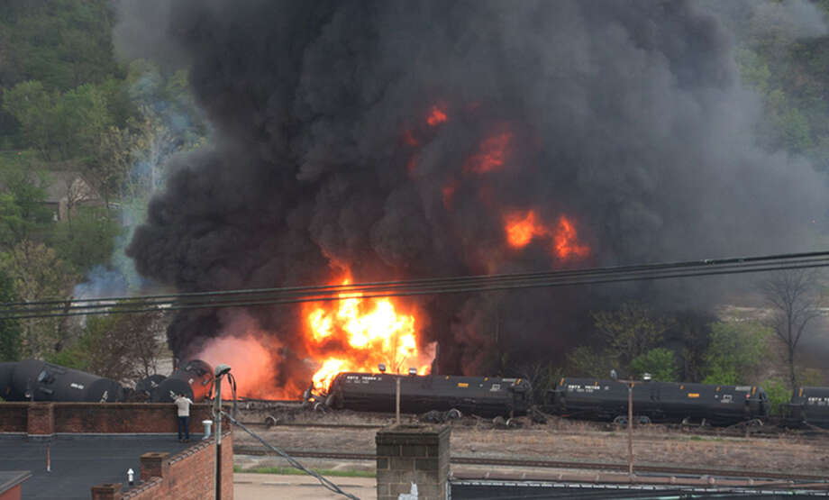 """This image made available by the City of Lynchburg, Va., shows several CSX tanker cars carrying crude oil in flames after derailing Wednesday. One observer of the wreck said, """"You could feel the heat like you were standing by a campfire."""" Photo: LuAnn Hunt, HOPD / City of Lynchburg"""