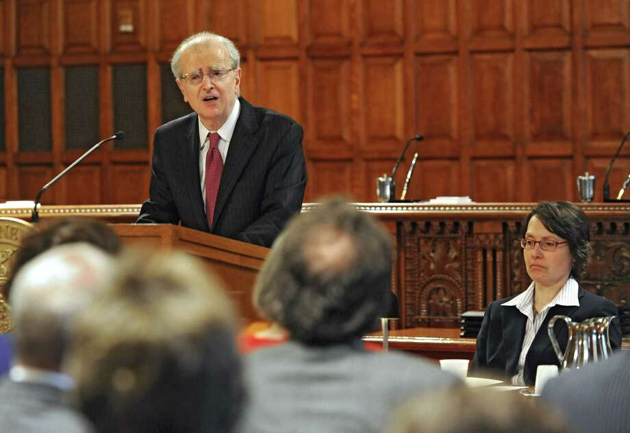 Chief Judge Jonathan Lippman proposes comprehensive reforms to the legal process for consumer debt cases during the chief judge's annual State of the Judiciary address Wednesday, April 30, 2014, at the Court of Appeals in Albany, N.Y Court of Appeals judge Jenny Rivera sits at right. (Lori Van Buren / Times Union) Photo: Lori Van Buren / 00026676A
