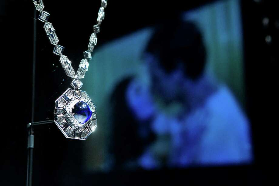 The Sautoir in platinum with sapphires and diamonds of 1969 was a gift from Richard Burton to Elizabeth Taylor in 1972 for her fortieth birthday. A reflection of a projection of Elizabeth Taylor is seen beside the jewel at the Houston Museum of Natural Science Bulgari: 130 Years of Masterpieces exhibition, Tuesday, April 29, 2014, in Houston. ( Marie D. De Jesus / Houston Chronicle ) Photo: Marie D. De Jesus, Staff / © 2014 Houston Chronicle