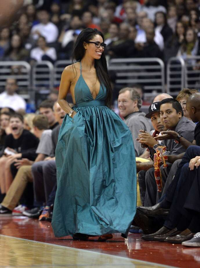 V. Stiviano, center, walks down the sideline as the Los Angeles Clippers play the Sacramento Kings during the first half of an NBA basketball game, Friday, Oct. 25, 2013, in Los Angeles. Photo: Mark J. Terrill, Associated Press