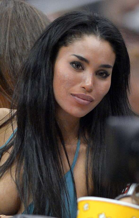 V. Stiviano, center, watches the Los Angeles Clippers play the Sacramento Kings during the first half of their NBA basketball game, Friday, Oct. 25, 2013, in Los Angeles. Photo: Mark J. Terrill, Associated Press