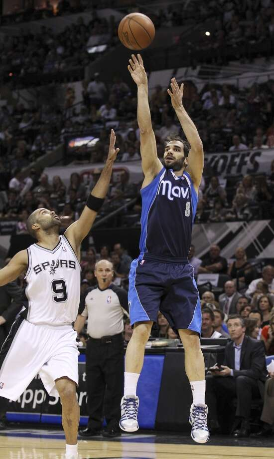 Dallas Mavericks' Jose Calderon (08) shoots over Spurs' Tony Parker (09) in the first half of Game 5 of the first round of the Western Conference playoffs at the AT&T Center on Wednesday, Apr. 30, 2014. Photo: Kin Man Hui, San Antonio Express-News
