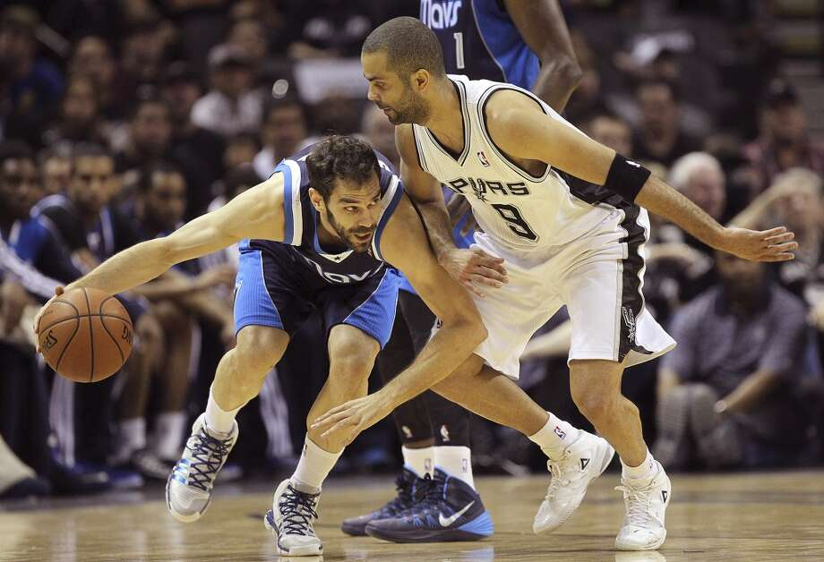Dallas Mavericks' Jose Calderon attempts to get around San Antonio Spurs' Tony Parker during the first half of game five in the first round of the Western Conference Playoffs at the AT&T Center, Wednesday, April 30, 2014. Photo: Jerry Lara, San Antonio Express-News